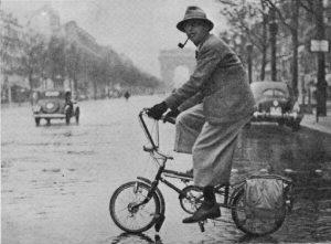 Jean-Paul Sarte riding a Le Petit Bi in Paris - Source Pinterest